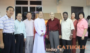 Representatives from different churches and faith posing with Archbishop John Ha (centre)